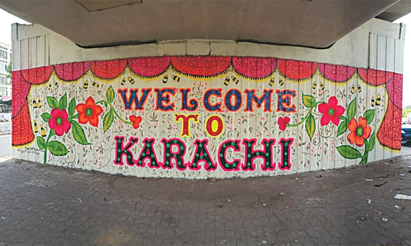 A decorated wall under the bridge at the Jinnah International Airport