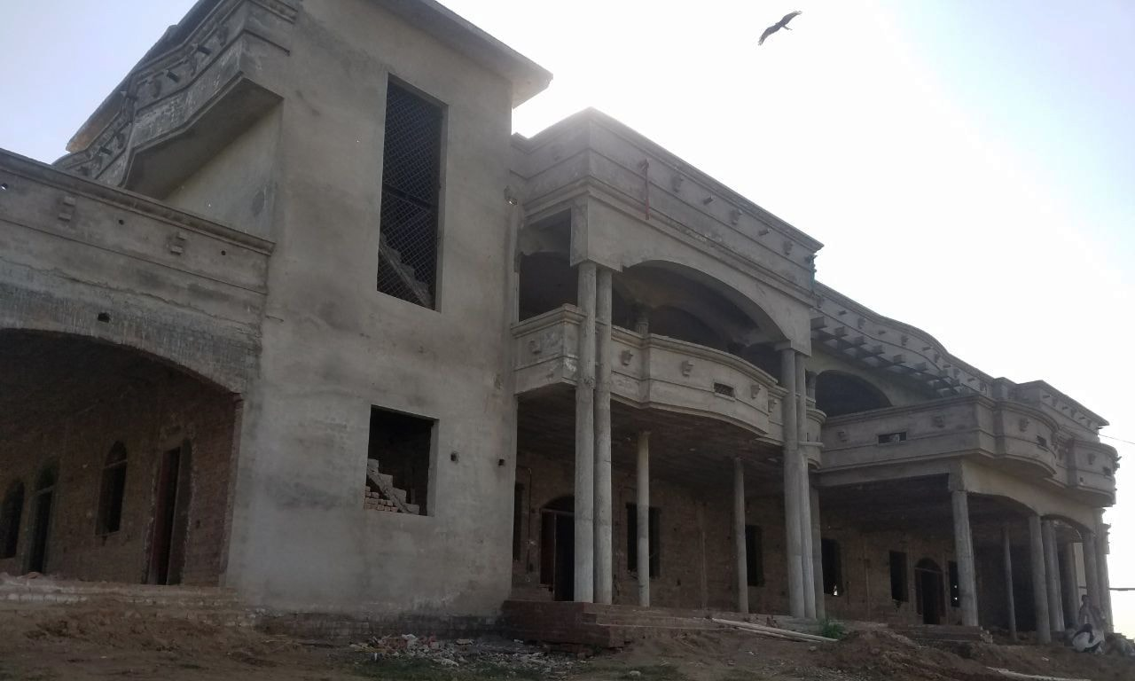 A palatial house, owned by an overseas Pakistani settled in Europe, under construction near Fatta Bhand village in Gujrat district. — Waseem Ashraf Butt