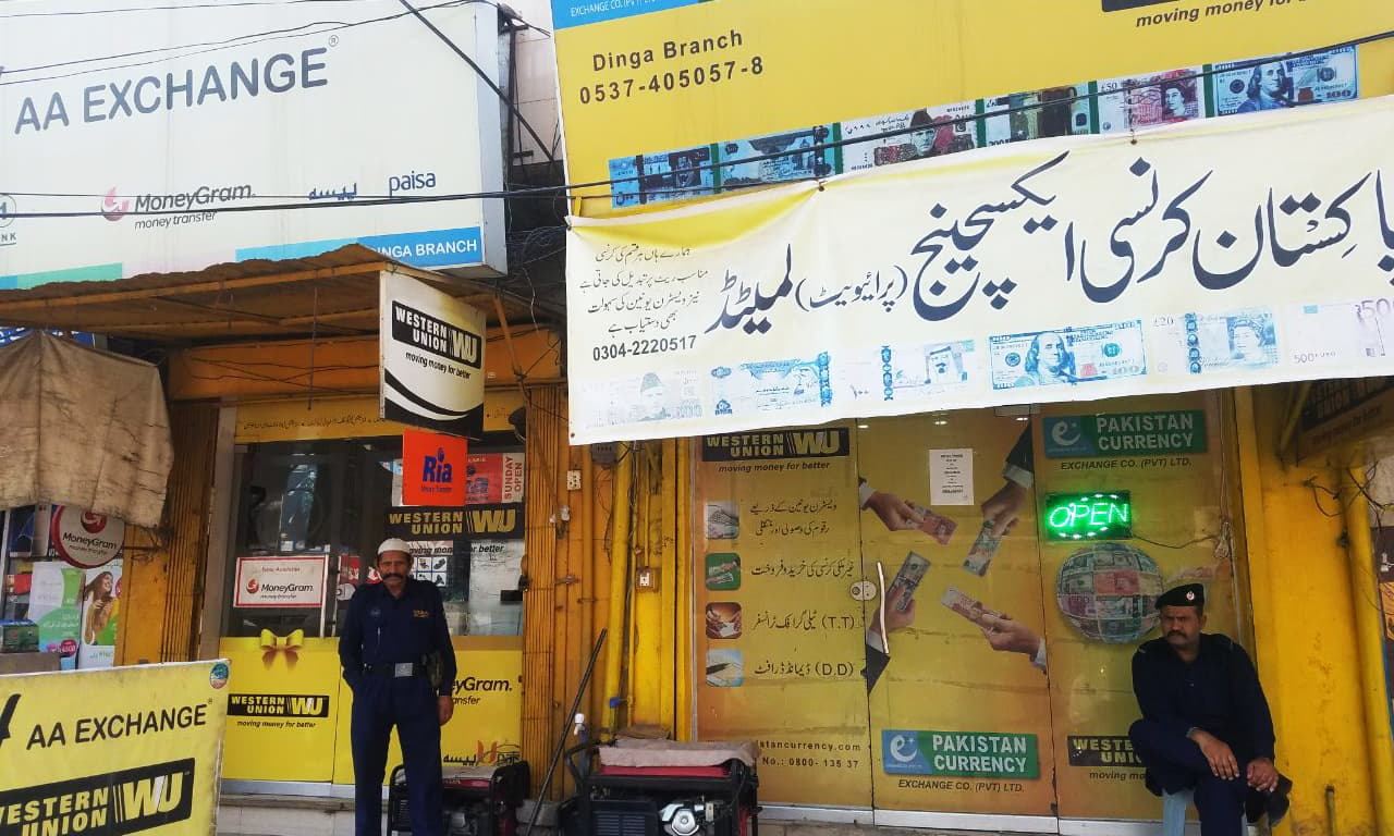 One of many foreign currency exchange shops in the small city of Dinga in Gujrat district that caters to foreign remittance needs of expatriates belonging to the area. — Waseem Ashraf Butt