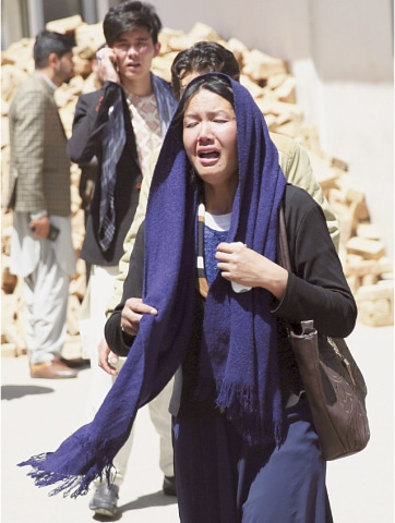 Kabul: A woman cries outside a hospital after learning that she had lost a relative in the suicide attack.—AP