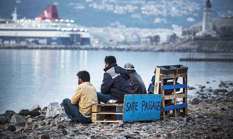 Pakistani men at the No Borders camp at the port of Mytilene, Lesbos island, on April 7, 2016. They are on high alert since the local mayor insisted that they abandon the camp and go to Moria, a closed camp where migrants live in prison-like conditions. This week Greece began deporting migrants, the vast majority Pakistani, to Turkey. — Jodi Hilton