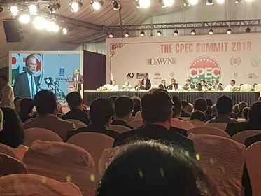 Planning Minister Ahsan Iqbal addressing the CPEC Summit. — DawnNewsTV