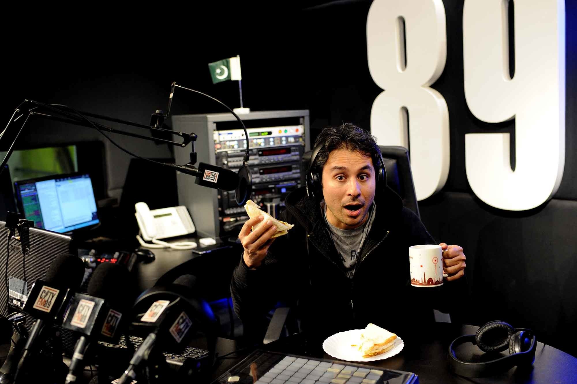 Internationally acclaimed actor, writer and stand-up comedian Saad Haroon enjoys his breakfast during a break while hosting the Breakfast Show on CityFM89. Haroon was one of the first comedians in Pakistan to perform in English. He co-founded Blackfish, Pakistan's first English-language comedy troupe in the early 2000s. Later, he began performing as a solo stand-up comedian. Cheeky, irreverent and witty, Haroon brings his own brand of enthusiasm to the Breakfast Show which was previously hosted by the much loved Khalid Malik. CityFM89 is part of The Dawn Media Group and started broadcasting in 2004. It rapidly acquired a sizeable audience due to its innovative and eclectic programming. (photo: Arif Mahmood/ Dawn White Star)