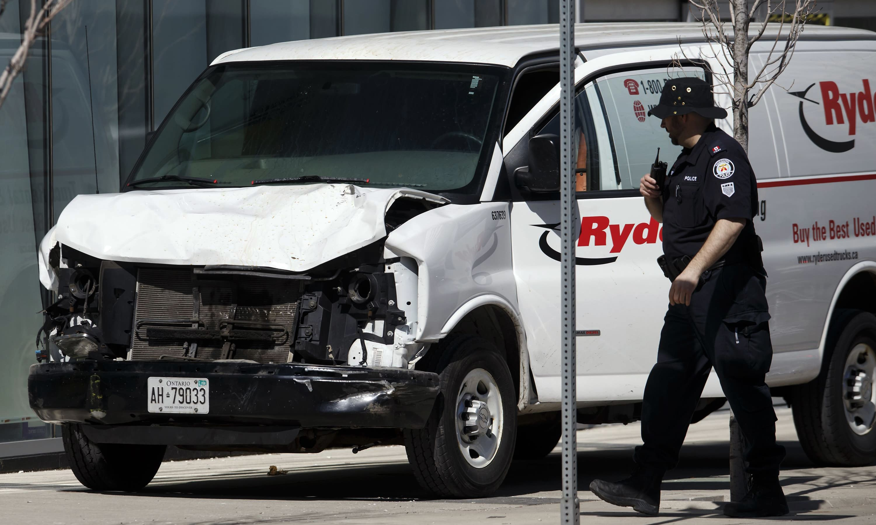 Police inspect a van involved in a collision at Yonge St. and Finch Ave. in Toronto. —AFP