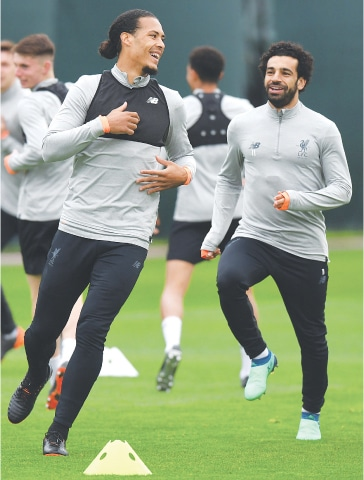 LIVERPOOL'S Virgil van Dijk (L) and Mohamed Salah attend a training session at the team's Melwood training complex on Monday.—AFP