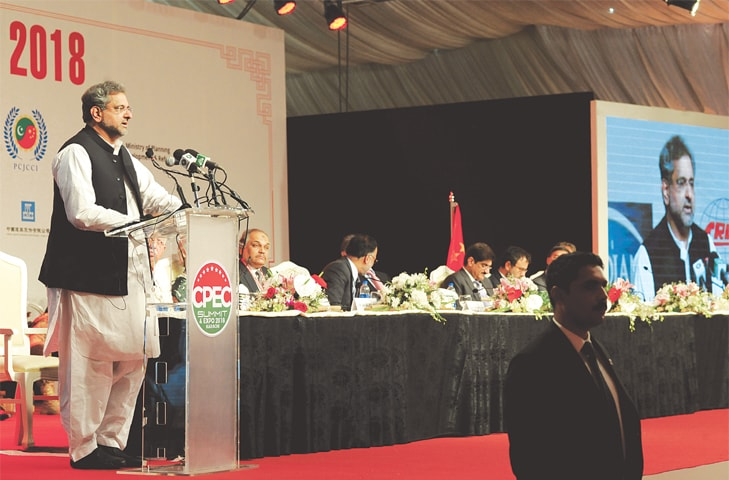 PRIME Minister Shahid Khaqan Abbasi speaking at the CPEC Summit on Monday.—Arif Mahmood / White Star
