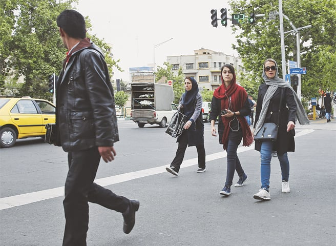 PEDESTRIANS cross a street in downtown Tehran, Iran.—AP