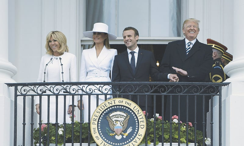 WASHINGTON: US President Donald Trump, his French counterpart Emmanuel Macron, Melania Trump and Brigitte Macron pictured at a state reception at the White House on Tuesday.—AFP
