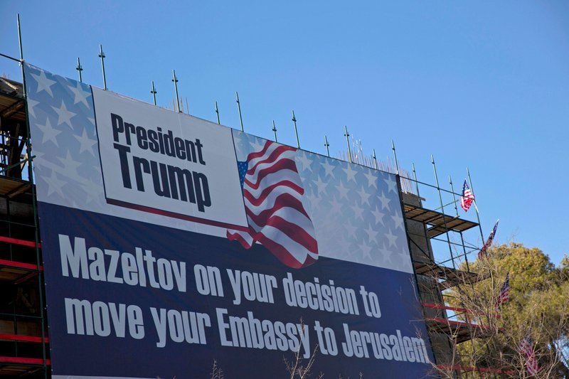 In this January 20, 2017, file photo, a sign hangs on a building under construction in Jerusalem. — AP