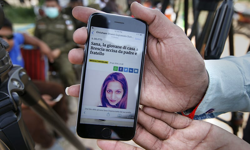A local journalist shows a story published by an Italian news site regarding Sana Cheema. — AP