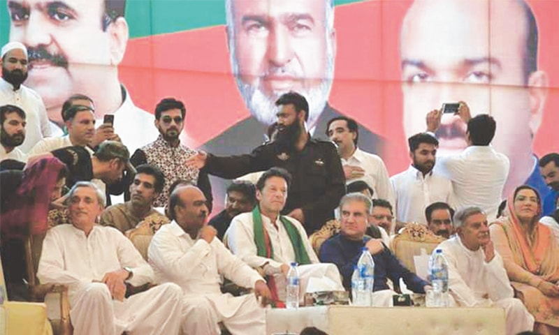 IMRAN Khan and other leaders of the Pakistan Tehreek-i-Insaf pictured at a rally in Mandi Bahauddin on Wednesday.