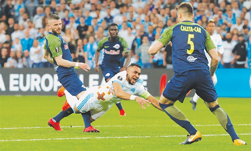 MARSEILLE: Olympique de Marseille's Dimitri Payet falls under a challenge from Salzburg's Valon Berisha during their Europa League semi-final first leg at the Stade Velodrome.—Reuters
