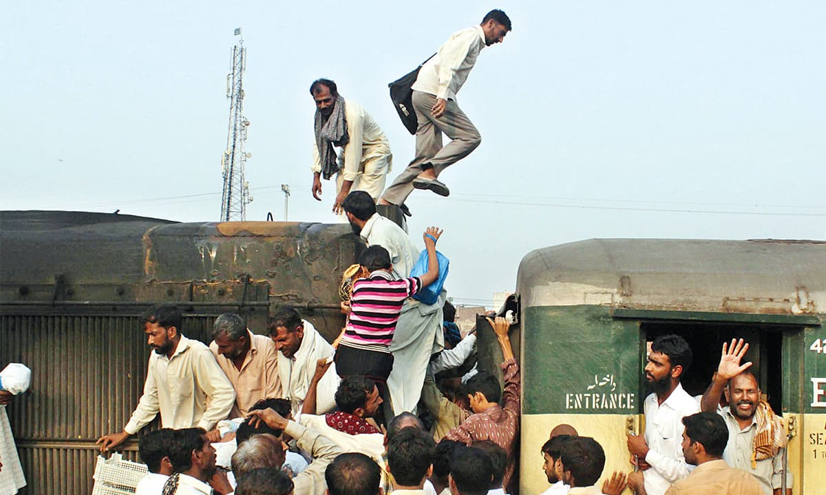 Passengers board a train at Lahore Railway Station | Tariq Mehmood, White Star