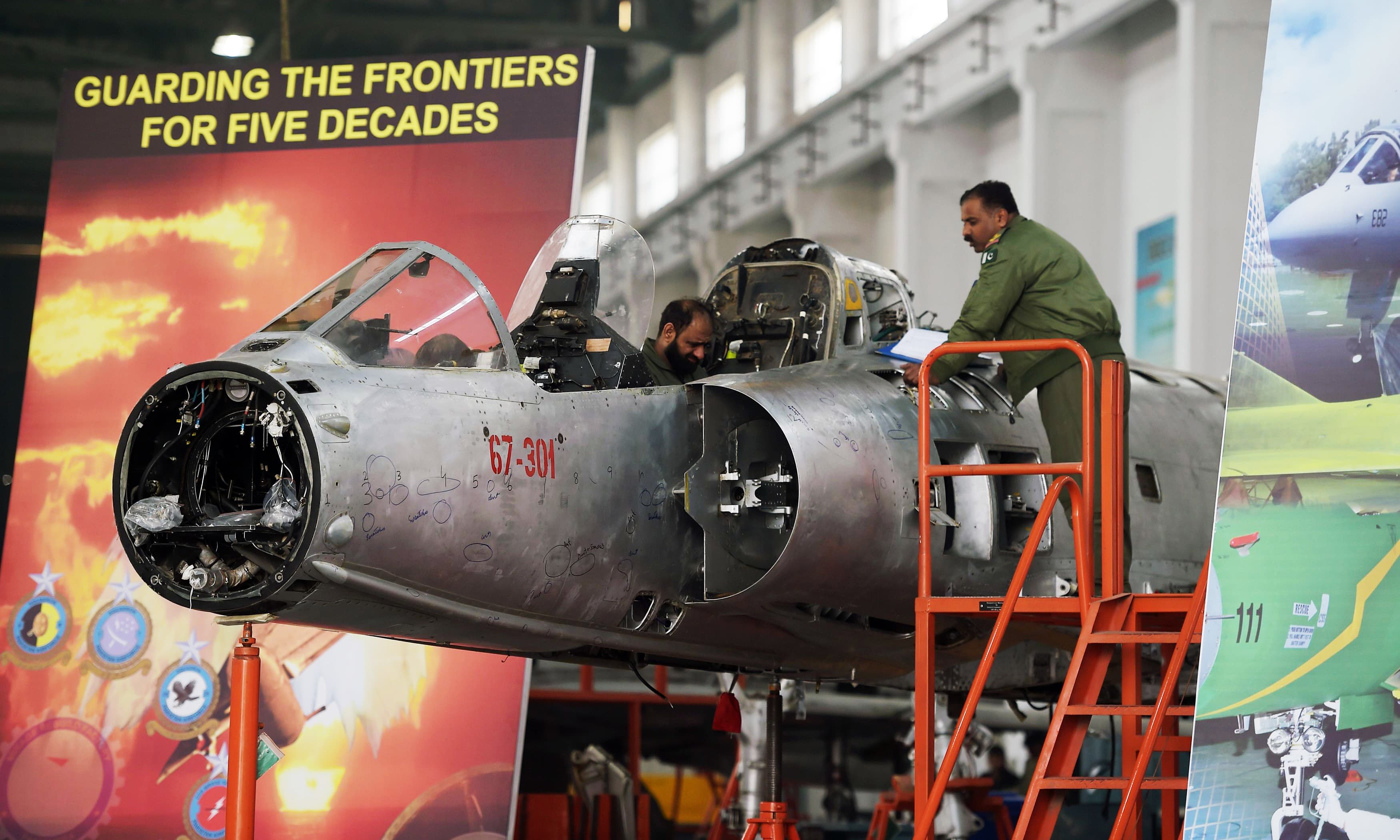 Technicians work on a Mirage aircraft during a full overhaul by PAF at Mirage Rebuild Factory in Kamra. —AFP