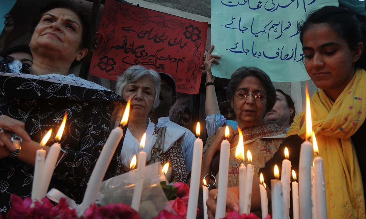 Civil society members hold a peace vigil for the Ahmadi community outside an Ahmadi prayer hall attacked in Lahore in 2010  | M Arif, White Star