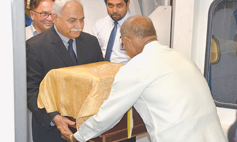Colombo: Sri Lankan Minister for Buddha Sasana Gamini Jayawickrema Perera receives Taxila Museum's Buddha relics from High Commissioner of Pakistan Dr Shahid Ahmad Hashmat (left). The relics have been sent to Sri Lanka to celebrate its most important annual Buddhist festival called Vesak.