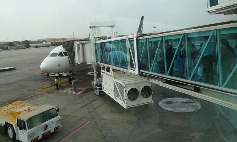 Passengers from Karachi board PK-300.