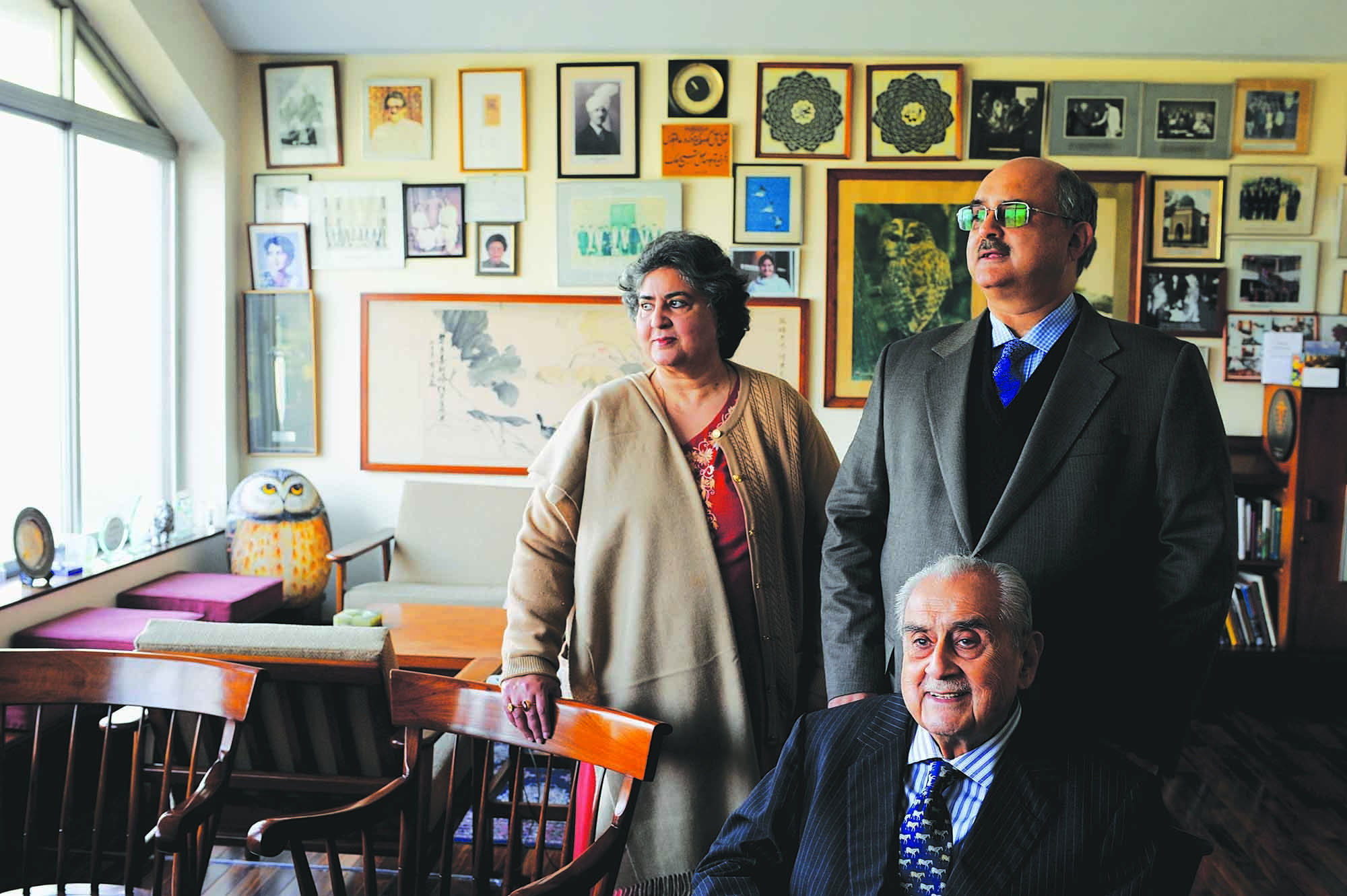 Syed Babar Ali is seated in his office at the Packages headquarters in Lahore. Standing behind him are his son Syed Haider Ali and his daughter Henna Babar Ali. Syed Babar Ali is one of Pakistan's most respected entrepreneurs and industrialists. He is the founder of Packages Limited, Pakistan's largest paper and board mill, which he established in 1956, as a joint venture between the Ali Group of Pakistan and Åkerlund and Rausing of Sweden. One of the most recognisable and successful brands under the Packages corporate umbrella is the premium-quality tissue paper Rose Petal, launched in 1982. Syed Babar Ali also set up Tetra Pak, Milkpak and Nestlé in Pakistan as joint ventures with multinationals. A defining characteristic of Syed Babar Ali is his ability to identify changing consumer dynamics and then develop business solutions to cater to them. Given the increasing demand for organised retail in Lahore, his latest venture was the launch of Packages Mall in 2017. Designed in line with international standards, the mall has redefined the shopping experience for the people of the city. (photo: Arif Mahmood/ Dawn White Star)