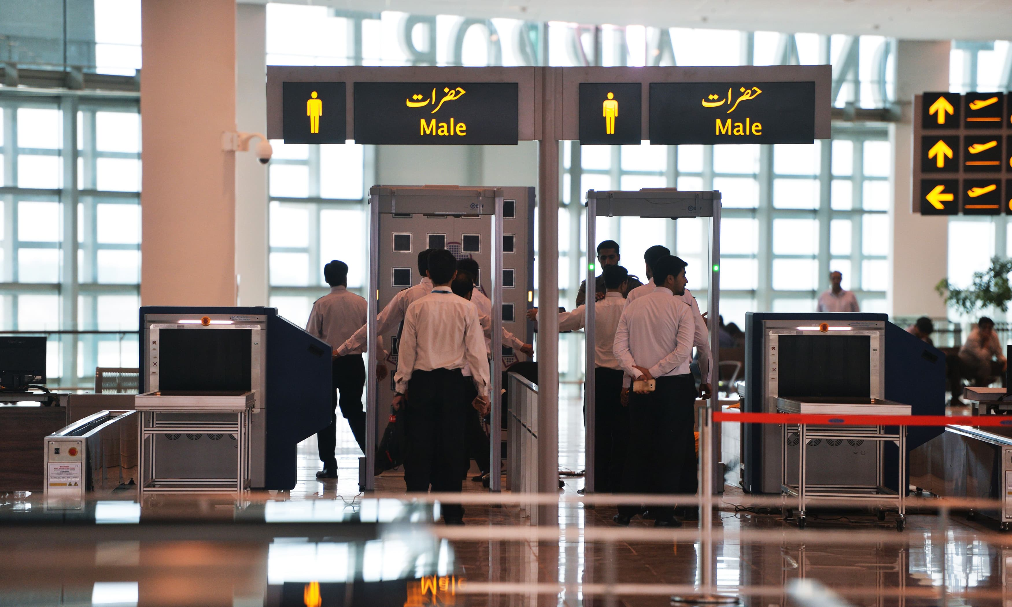 Airport staff walk through security at the new Islamabad International Airport ahead of its official opening on the outskirts of Islamabad. —AFP