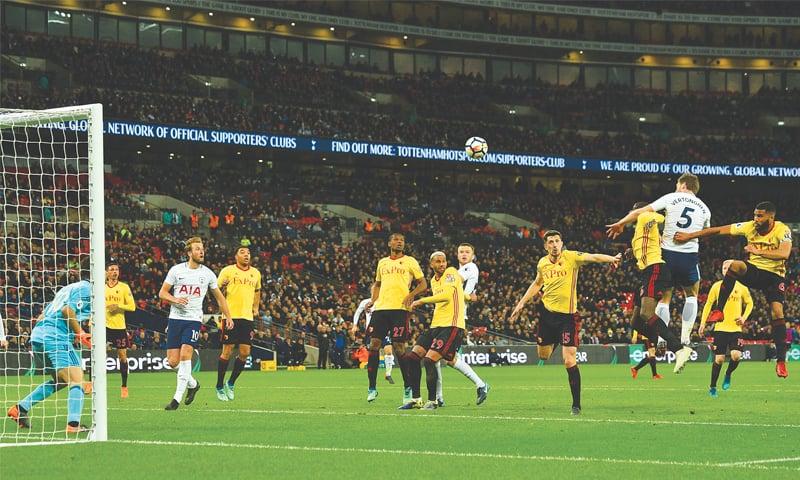 LONDON: Tottenham Hotspur's Jan Vertonghen (second R) heads at goal during the English Premier League match against Watford at Wembley Stadium.—AFP