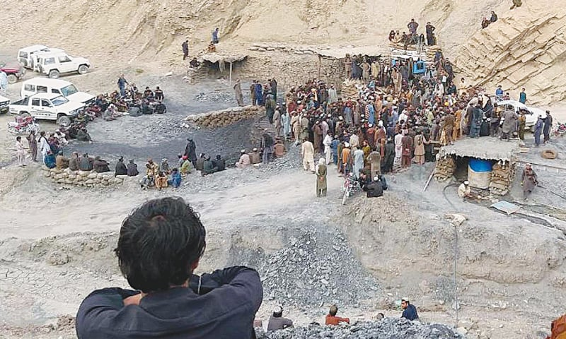 Rescue workers and others gather after a coal mine collapsed in the Marwar area on Saturday.—INP