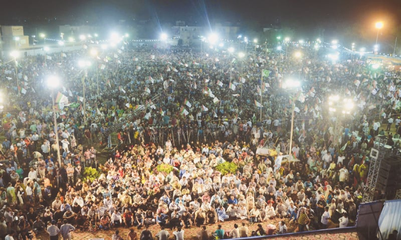 KARACHI: Thousands of people assemble in a Liaquatabad ground for a rally  jointly organised by two groups of the Muttahida Qaumi Movement-Pakistan here on Saturday night.—White Star