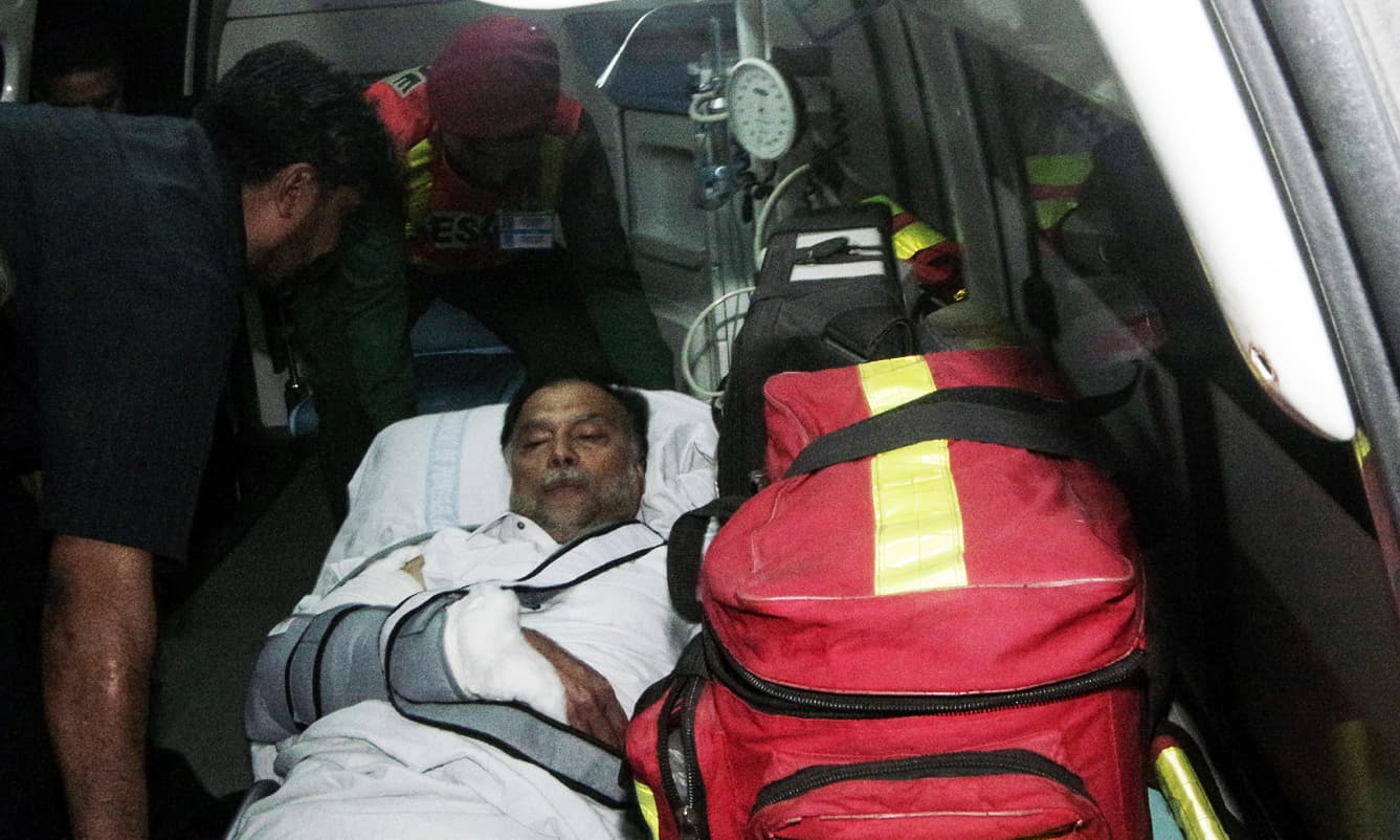 Ahsan Iqbal is evacuated from a helicopter after reaching Lahore. —PID