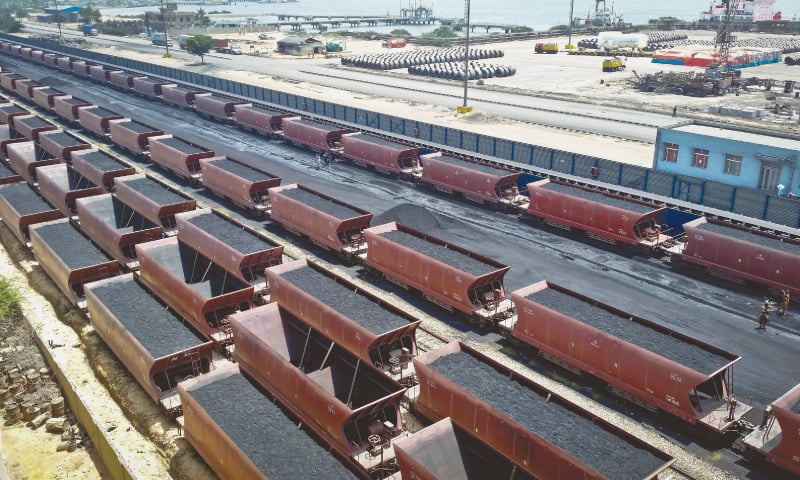 Coal being transported in open bogies in the Port Qasim area.—Fahim Siddiqi/White Star