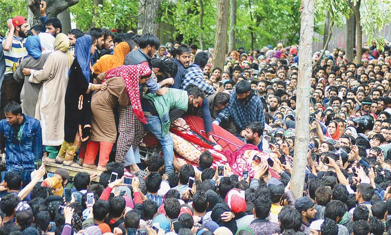 THOUSANDS attend the funeral of two Kashmiri fighters who were shot dead by Indian forces in Shopian district of India-held Kashmir on Sunday.—AFP