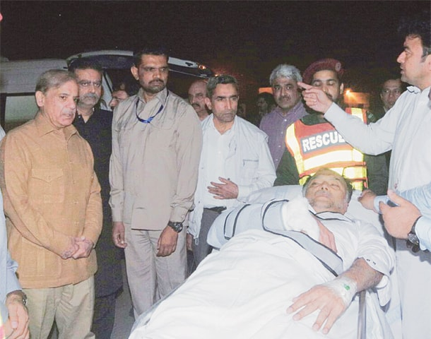 LAHORE: This handout picture released by the Punjab government shows Interior Minister Ahsan Iqbal being moved to an ambulance at the Lahore airport after he was brought here from Narowal by a helicopter.