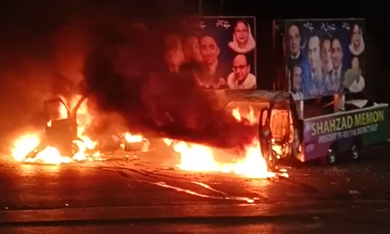Vehicles are set on fire during the clash. — DawnNewsTV
