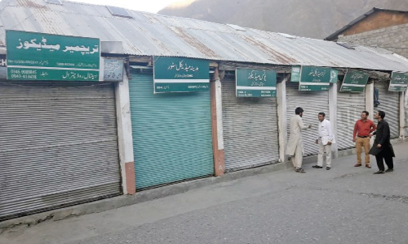 Medicine shops remained closed on Hospital Road, Chitral, on Tuesday. — Dawn