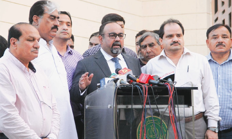 LEADER of the Opposition in the Sindh Assembly Khwaja Izharul Hasan, surrounded by leaders of opposition parties, speaks to the media after the budget session on Thursday.—PPI
