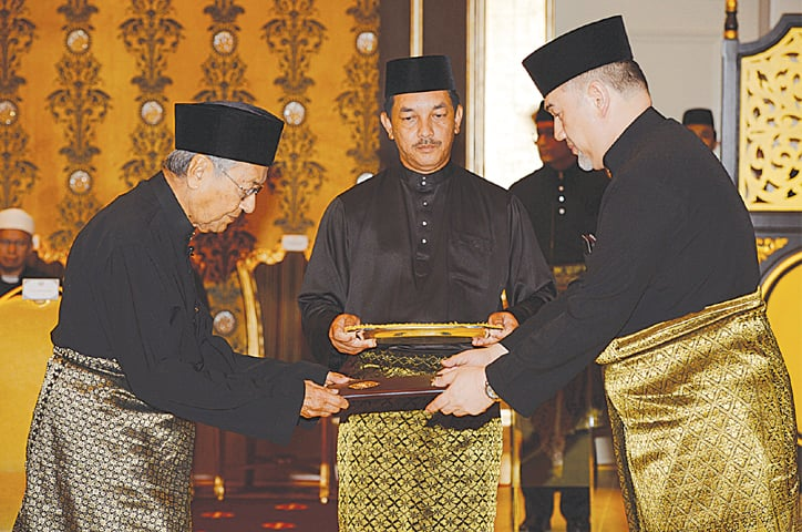 Mahathir sworn in as world's oldest leader after shock poll win