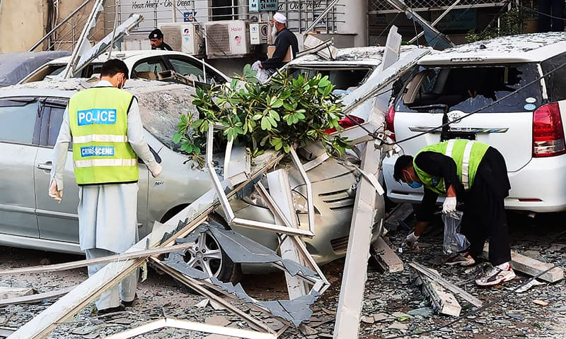 Pakistani police officials examine a local hotel building following a gas explosion in Peshawar.—AFP