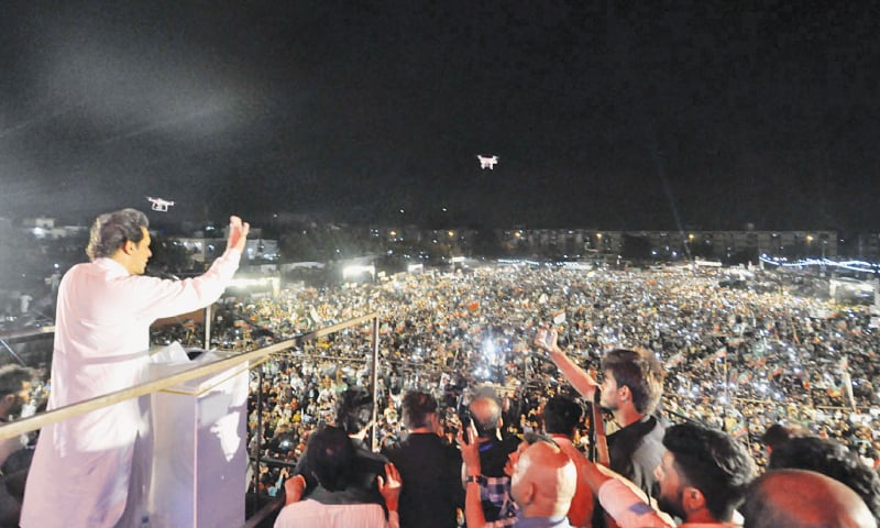 KARACHI: Pakistan Tehreek-i-Insaf chairman Imran Khan addresses his supporters during a public meeting held at Rashid Minhas Road on Saturday.—PPI
