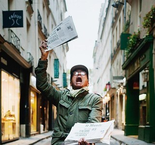 Ali Akbar yelling the day's headlines in the streets of Latin Quarter of Paris. — Photo provided by author