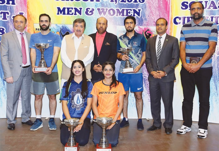 ISLAMABAD: Winners and runners-up of the Pakistan Squash Circuit-I pose with their trophies on Sunday.—INP