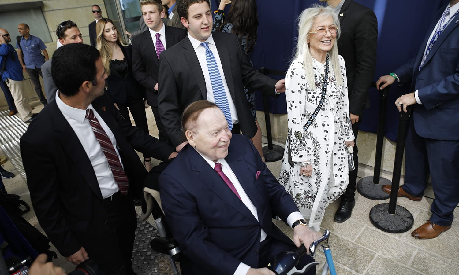 Chairman and chief executive officer of the Las Vegas Sands Corporation Sheldon Adelson (C) and his wife Miriam Ochsorn (R) arrive ahead of the inauguration of the US embassy in Jerusalem. — AFP