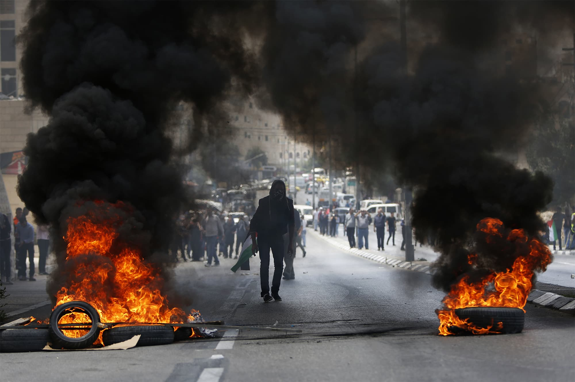 Palestinians clash with Israeli troops following a protest against the US decision to relocate it's Israeli embassy to Jerusalem, in the West Bank city of Bethlehem on Monday, May 14, 2018. ─ AP