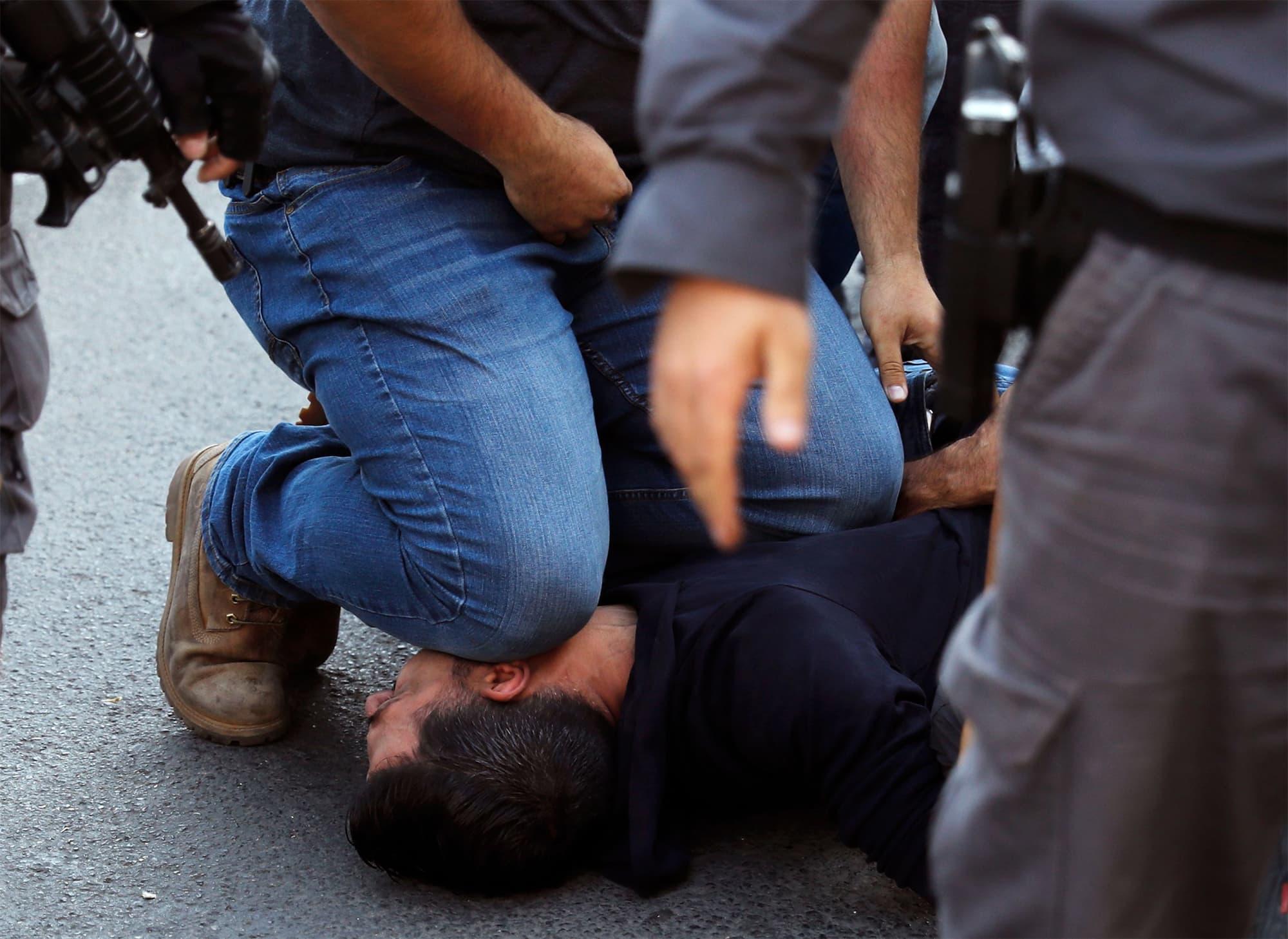 Israeli security forces arrest an Arab protestor outside the new US embassy in Jerusalem. — AFP