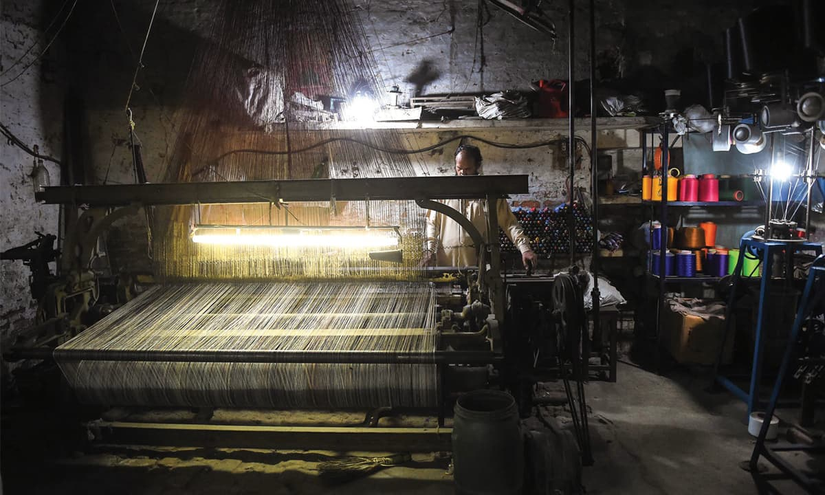 A machine-made carpet loom that runs on electricity and is operated by a pedal