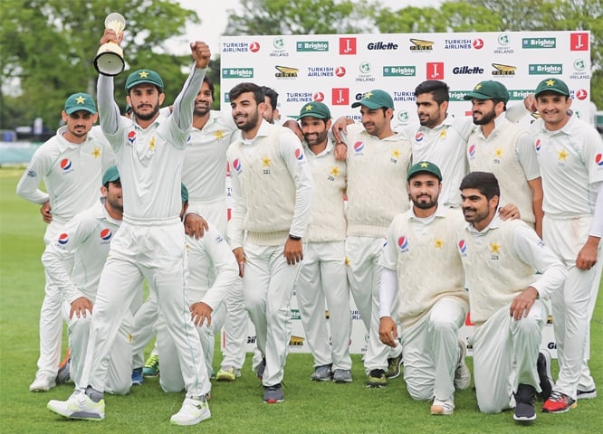 Dublin: Members of Pakistan's squad pose for a group photo after defeating Ireland in the one-off Test on Tuesday.—AP