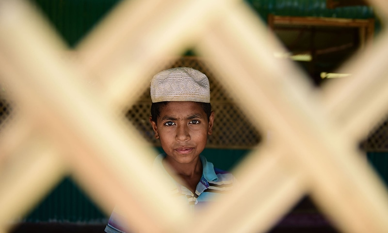 A Rohingya youth looking out from a mosque as he attends afternoon prayers at a refugee camp in Ukhia, Cox's Bazar. — AFP