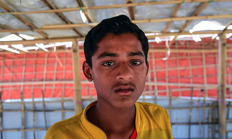 12-year-old MD Hashim posing for a photo at a refugee camp in Ukhia, Cox's Bazar. — AFP