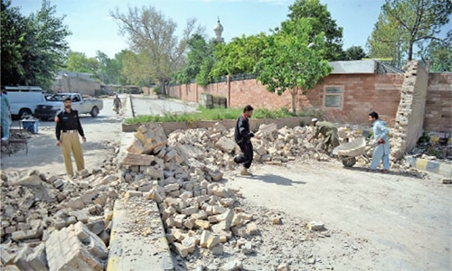 Police get two checkposts from army, demolish security wall in Peshawar