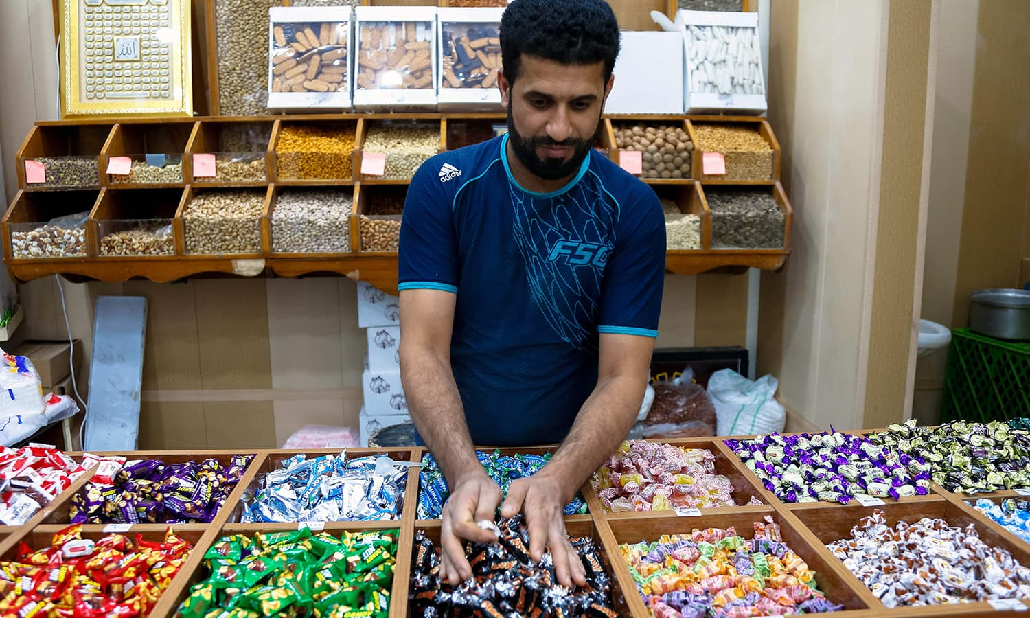 An Iraqi vendor restocks his chocolate shop in the central holy city of Najaf. — AFP