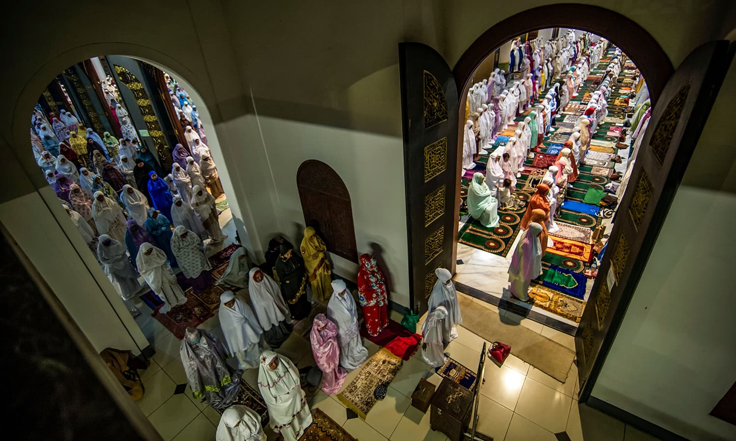 Indonesian Muslims pray during the start of the holy month of Ramazan at the Al Akbar Mosque in Surabaya, East Java province. — AFP