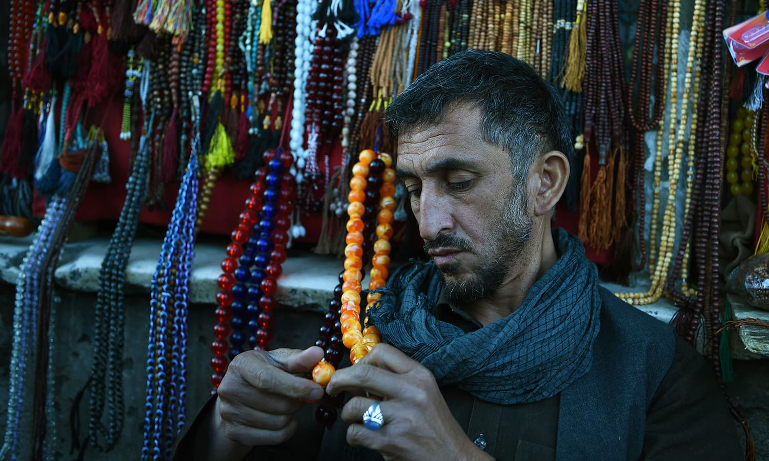 An Afghan vendor prepares prayer beads for sale ahead of the holy month of Ramazan at Pul-e-Khishti Mosque in Kabul. — AFP
