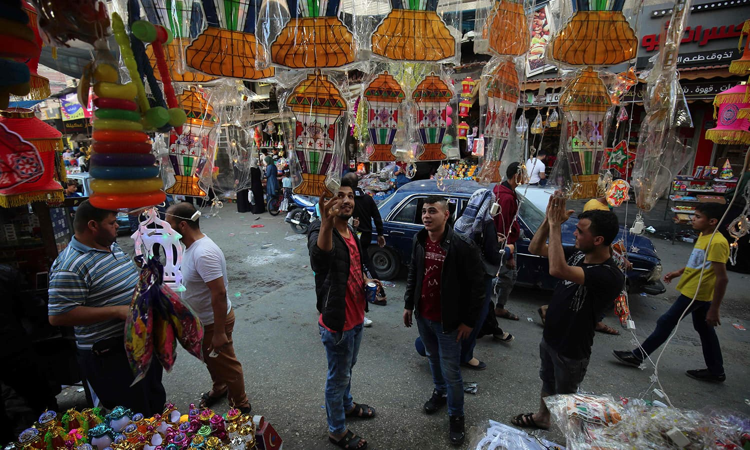 Palestinians shop at a market in Khan Yunis in the southern Gaza Strip. — AFP